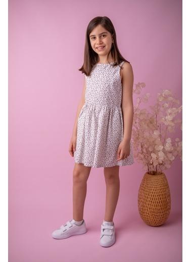 Mininio Bej Fiyonklu Desenli Elbise (5-14yaş) Bej Fiyonklu Desenli Elbise (5-14yaş) Bej